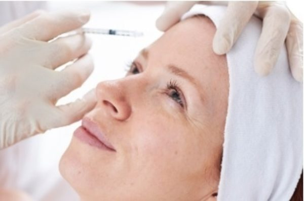 A lady receiving a Botox injection