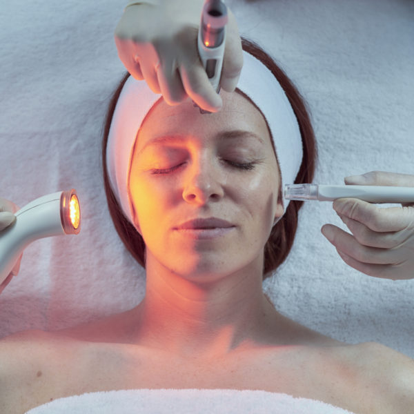 A lady receiving the DermaFrac treatment