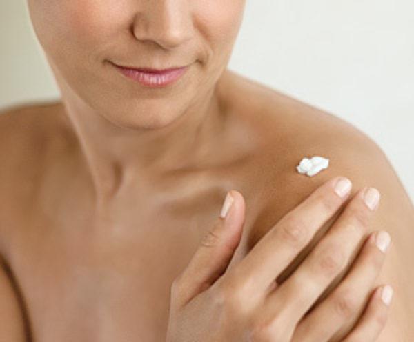 A lady applying cream